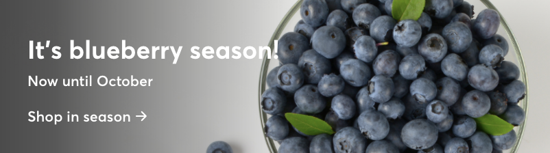 """Image of a bowl of blueberries with text """"It's blueberry season! Now until October. Shop in season."""""""